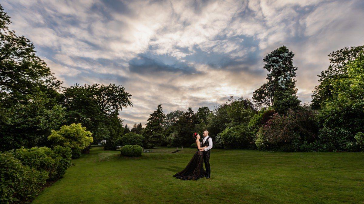 Black Wedding Dress - Tim Burton Inspired Red and Black Styled Wedding at Rowhill Grange Kent