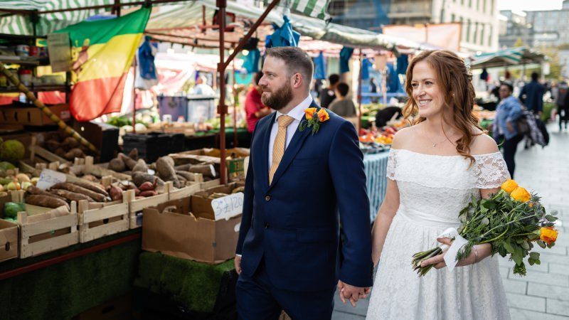 Bride and Groom walking in Woolwich Market London
