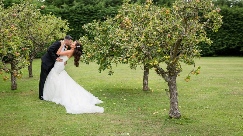 Bride and Groom Kissing in the grounds of Winters Barns Canterbury Kent